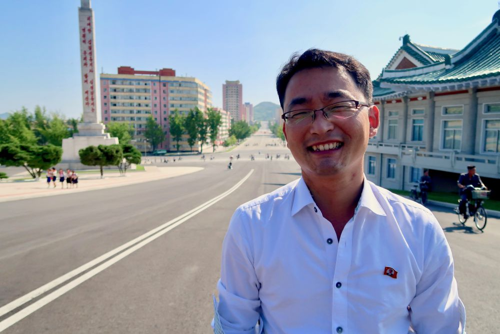 A male KITC guide smiles for the camera in Pyongyang.