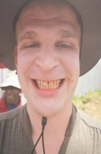 Pier having a red papua smile after chewing betelnut in Papua New Guinea