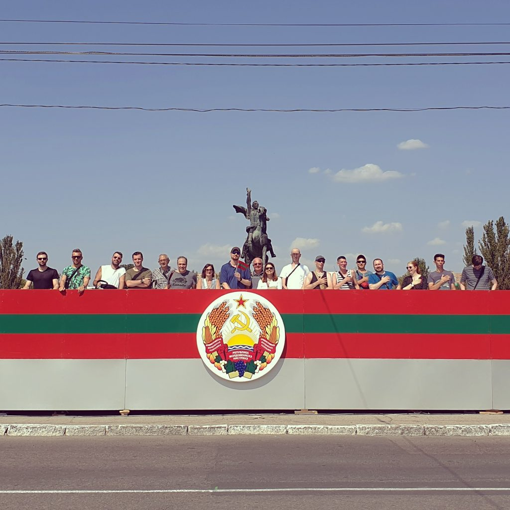 Our group standing on the Presidential stage during the National Day parade of Transnistria in Tiraspol