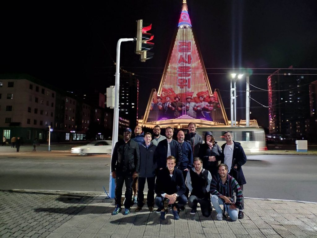 YPT stands in front of the Ryugyong hotel in Pyongyang