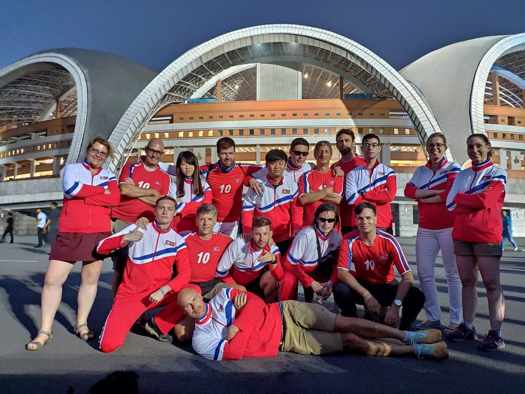 Our group wearing North Korean tracksuit in front of the May Day Stadium