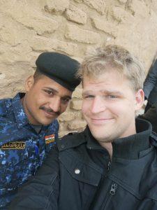 Two men taking photos in Iraq