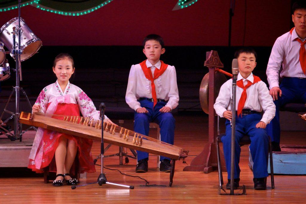 Children playing Kayagum, a traditional Korean instruments