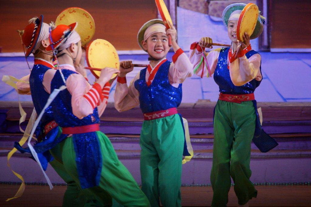 Dancers during a performance at the Mangyongdae Palace
