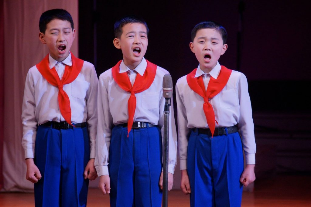 North Korean schoolboys singing during a performance at the Mangyongdae School