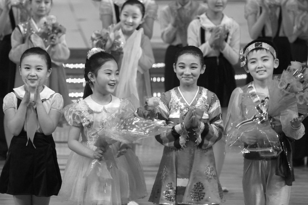 North Korean children being applauded