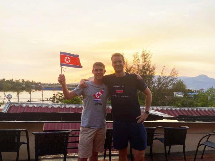 Our guide Nic & Rowan waving the North Korean Flag