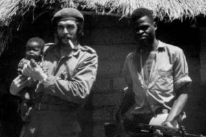 Che Guevara holding a baby in Zaire, later to become the DRC.