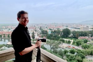 Making a North Korea documentary: Justin Martell overlooking a North Korean city.