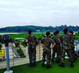 South koreans looking over to north korea