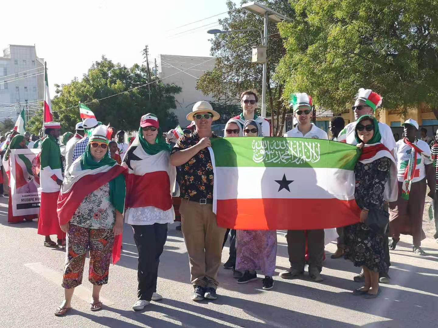 YPT holding the flag of Somaliland during the military parade