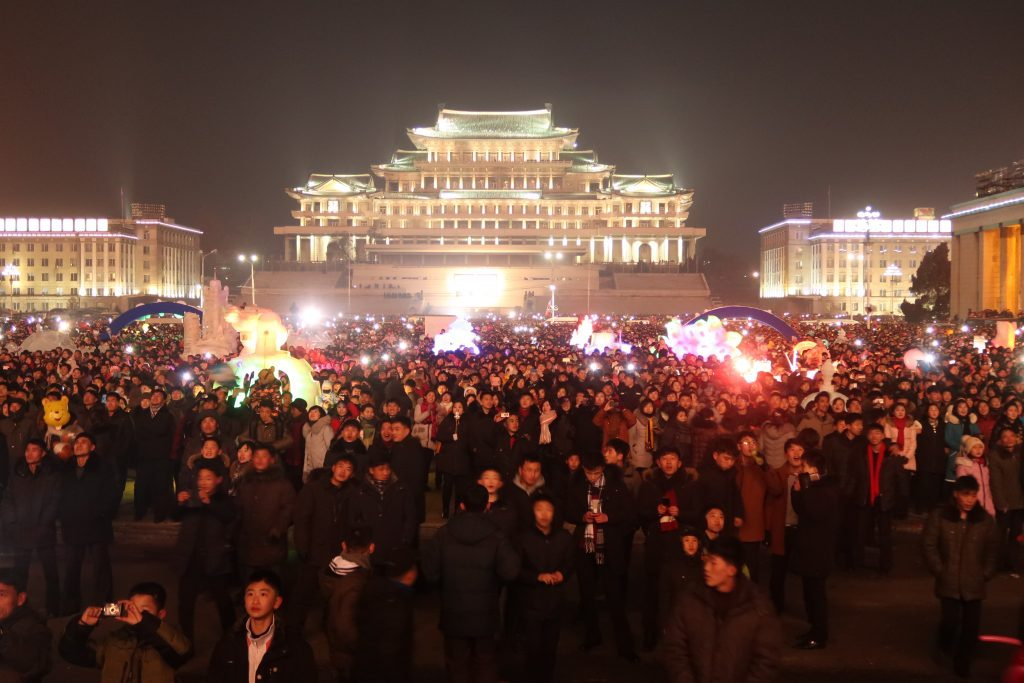 masses watching fireworks in Pyongyang