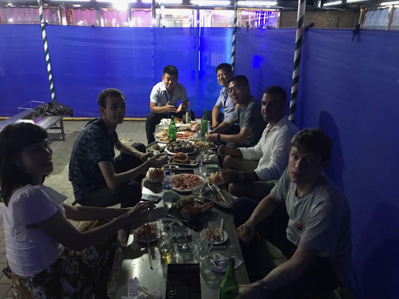 Rason: eating seafood at the local BBQ.