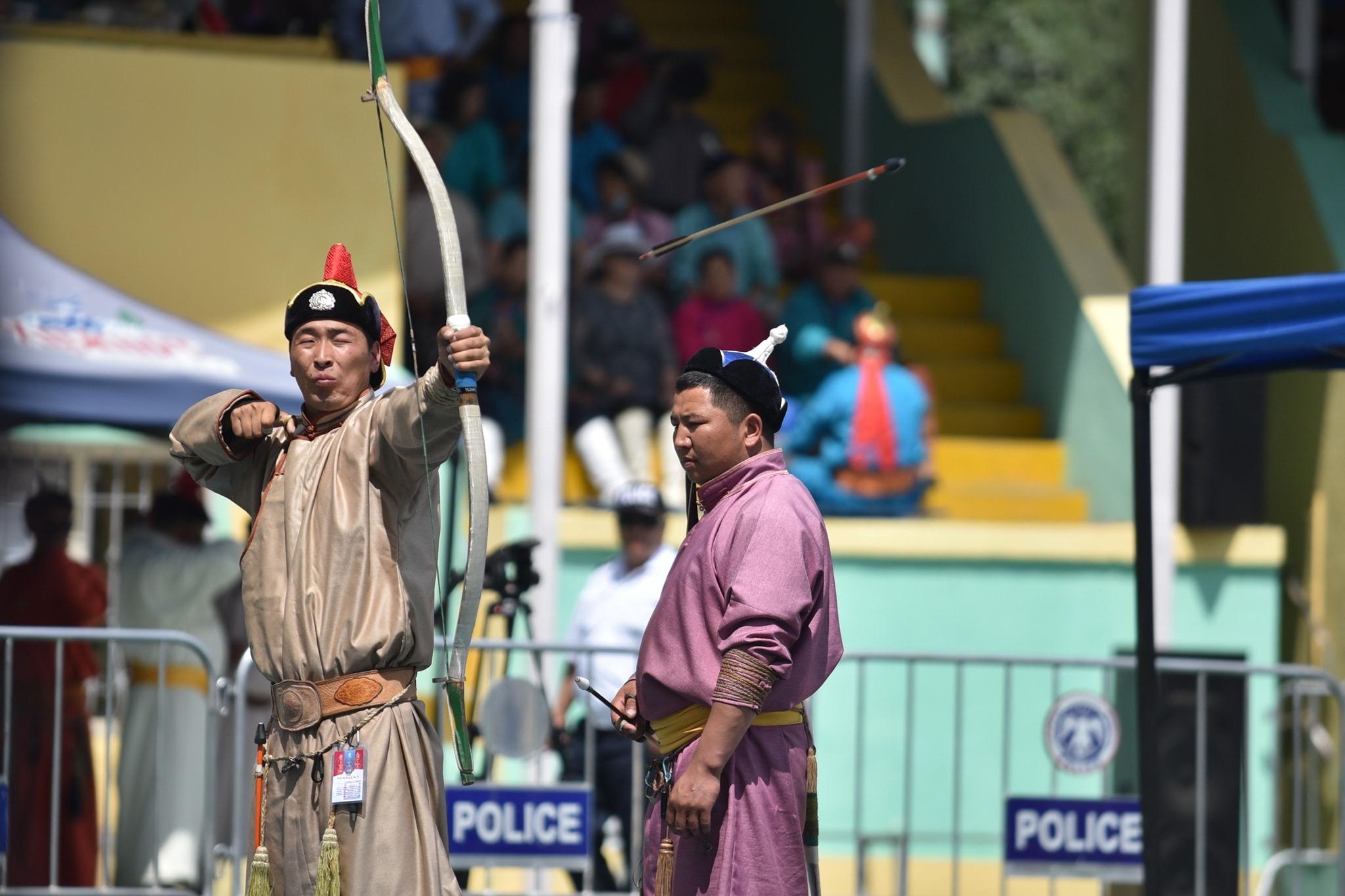 Mongolian Archery: an archer looses an arrow at the Ulaanbaatar archery competition.