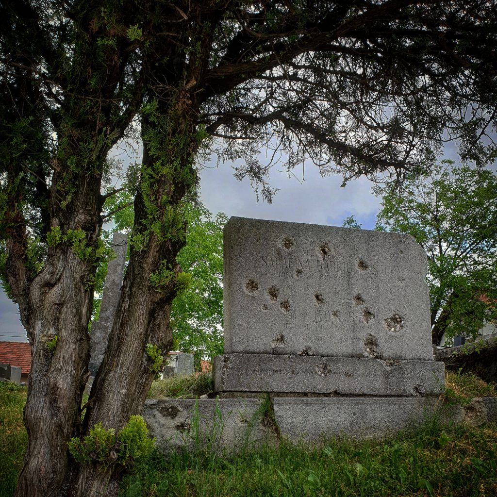 Dark history locations of the Balkans: a bullet-riddled gravestone outside Belgrade.