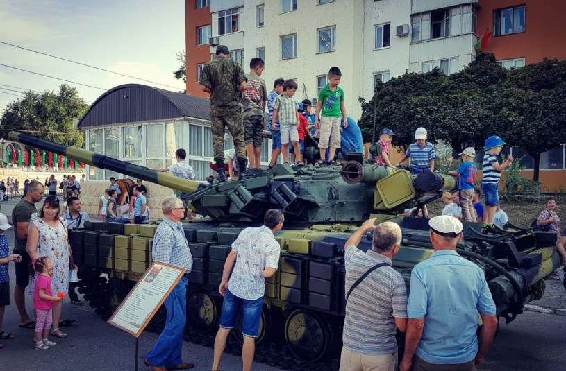 Festivals in Transnistria: children clamber on a tank as adults look on during Independence Day festivities in Tiraspol, Transnistria.