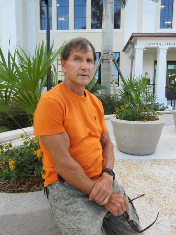 """Dan """"Tito"""" Davis, author of the bestselling """"Gringo"""", relaxes outside a hotel."""