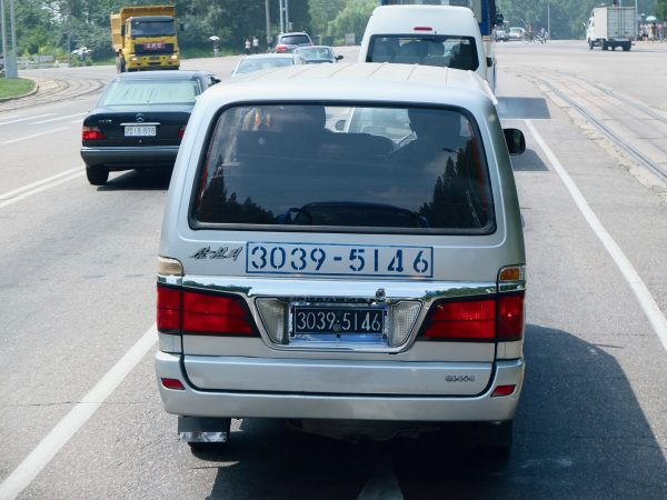 A black license plate in North Korea means a car owned by the military