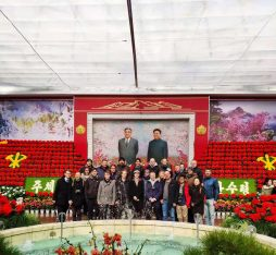 Our group standing in front of a mural of the leaders of the DPRK