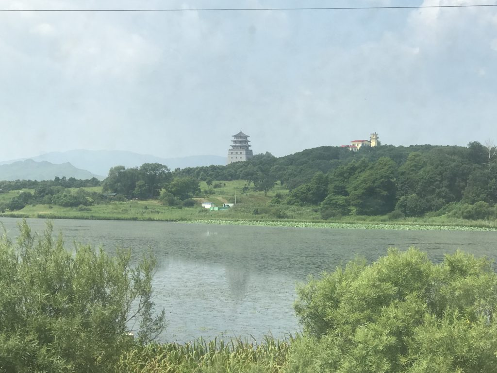 Russia-DPRK-China tripoint, with the Tumen pagoda across the river.