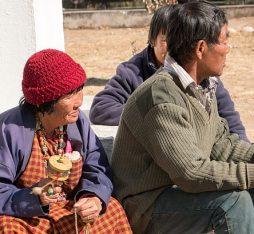 People holding prayer wheels in Bhutan