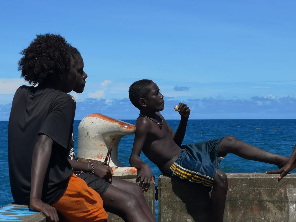 Youngsters are relaxing on the beach, a few kilometres away from the Solomon Islands