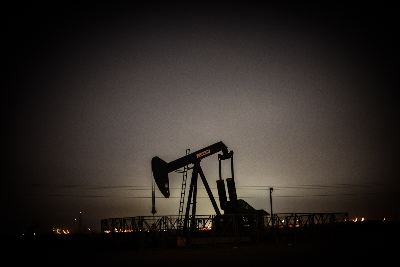 An oil rig at night, in Bahrain
