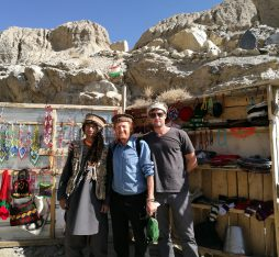 Pamir Highway: YPT guide Troy poses with a Tajik hat vendor along the Pamir Highway.