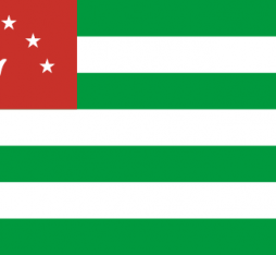 The national flag of Abkhazia: 6 horizontal stripes alternating between green and white and a small upper-left-hand red box containing an open white palm and seven white stars.
