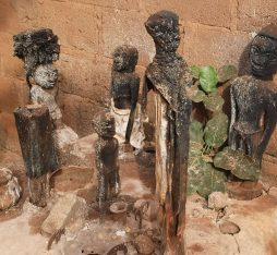 Different statues of voodoo gods