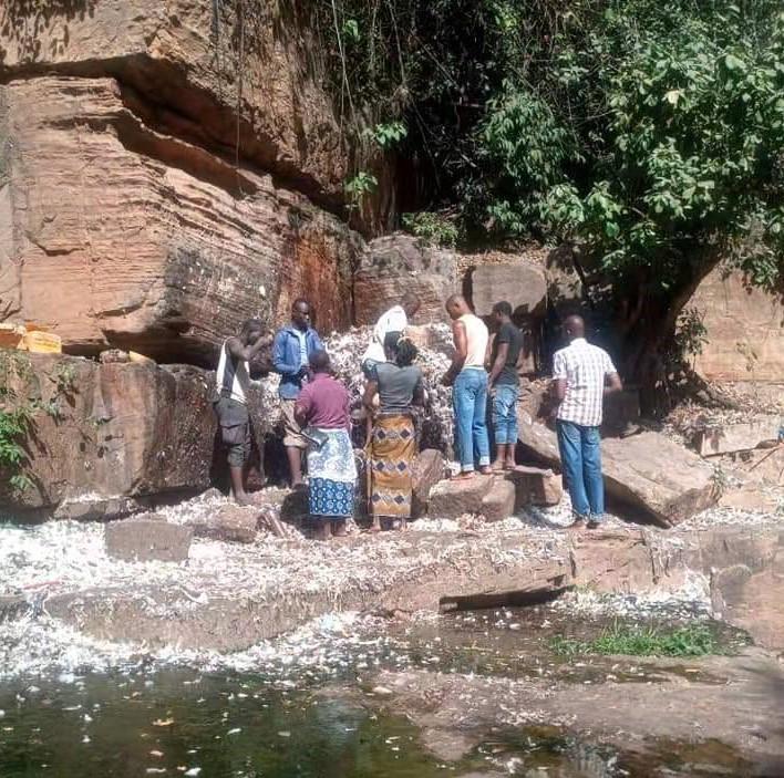 Locals at the sacrificial animist altar of Dafra, Burkina Faso