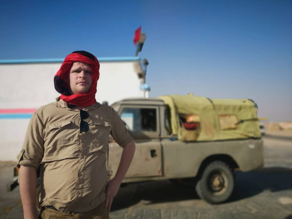 Showing off with a Sahrawi scarf in Western Sahara