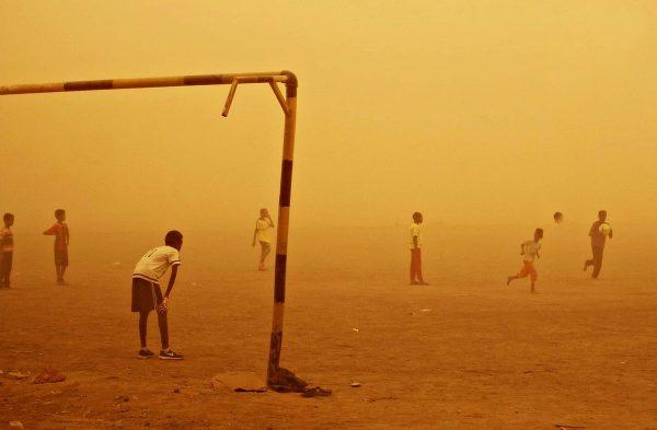 Kids playing football in Sudan
