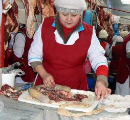 A woman prepares horse meat in Kazakhstan, taken by