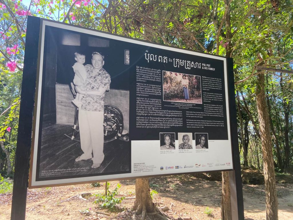 A sign with the history of Pol Pot